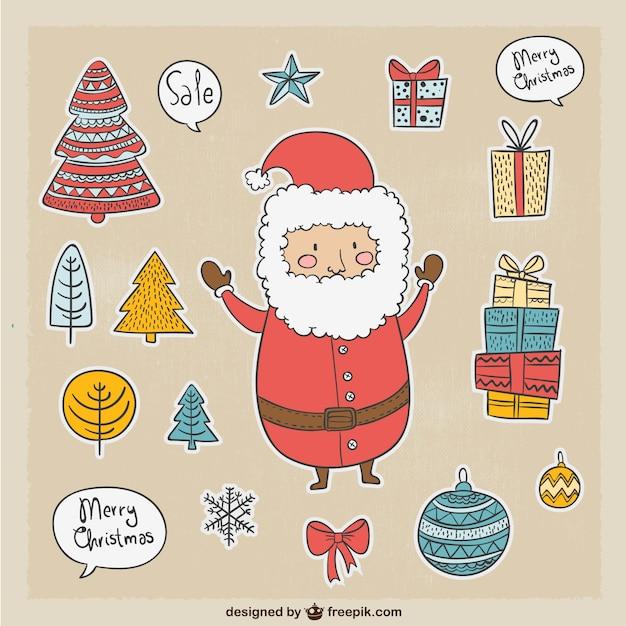 Leuke kerstman en andere kerst elementen Gratis Vector