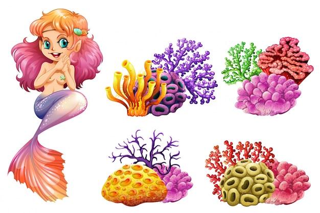 Leuke meermin en kleurrijke koraalriffen Gratis Vector