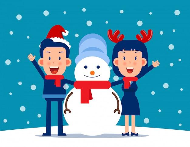 Leuke persoon en een sneeuwpop. winter seizoen concept Premium Vector