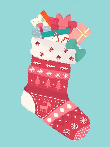 Leuke platte verscheidenheid van huidige dozen in rode kerstsok, gelukkig nieuwjaar en vrolijke kerstkaart Premium Vector