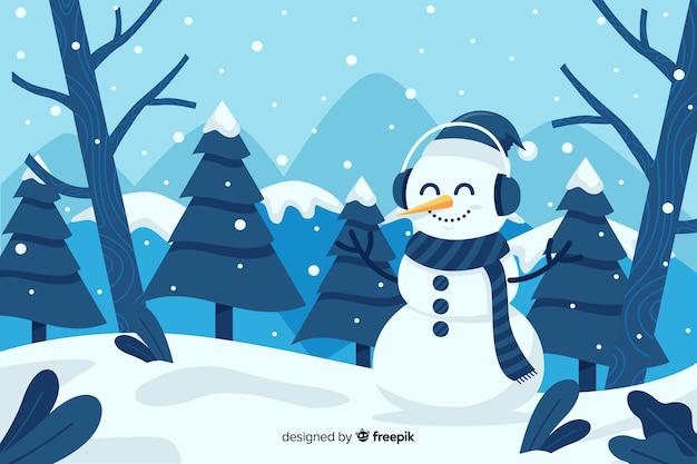 Leuke sneeuwpop die in het sneeuw vlakke ontwerp blijft Gratis Vector