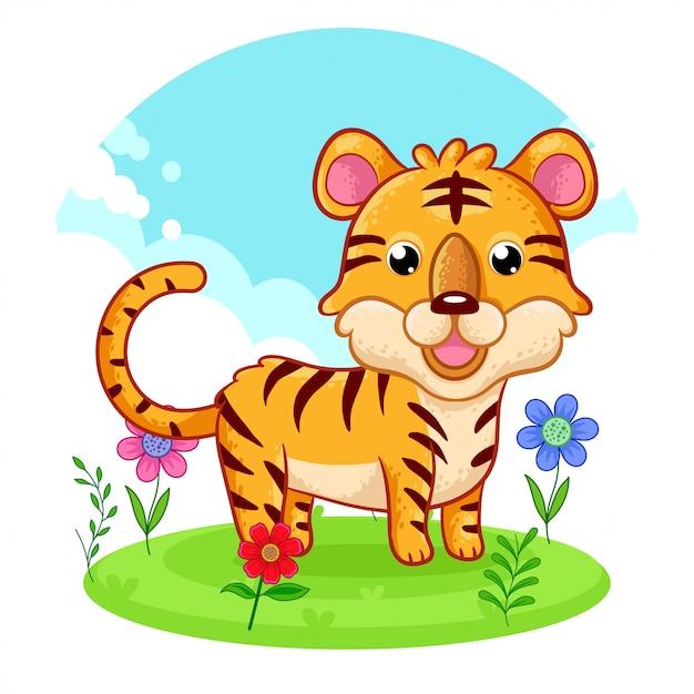 Leuke tijger die zich op een bloemweide bevindt. Premium Vector