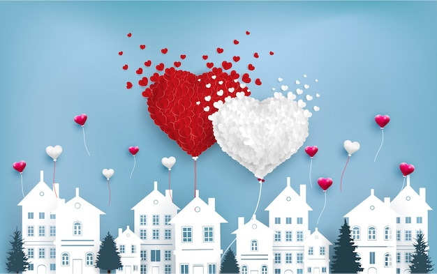 Liefdesballonnen vliegen over de stad Premium Vector
