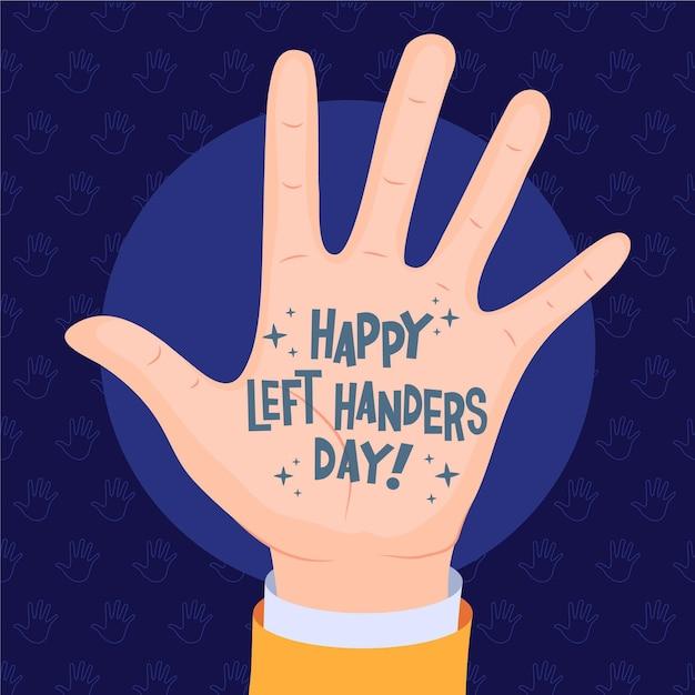 Linkshandige dag met bericht op palm Gratis Vector