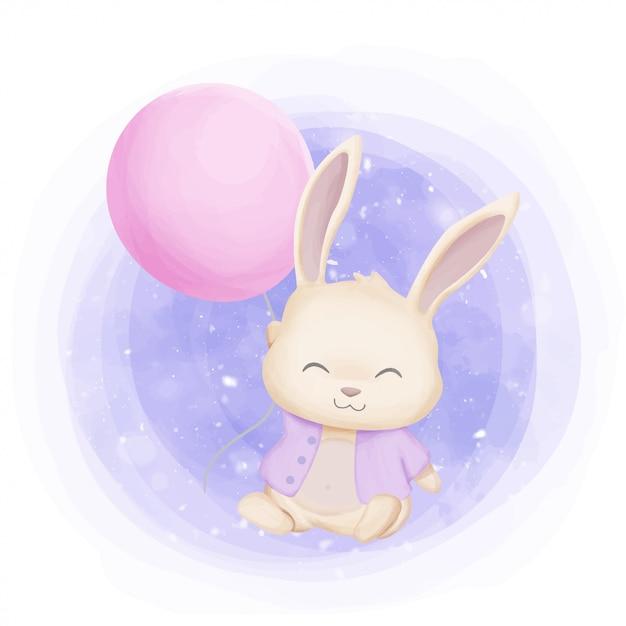 Little bunny playing met ballon Premium Vector