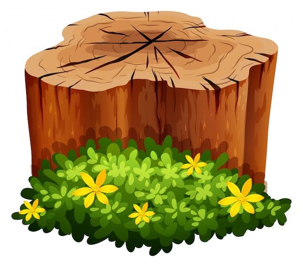 Log en groene struik Gratis Vector