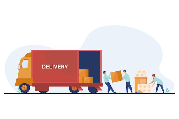 Logistieke werknemers die medicijnen afleveren. magazijnmedewerkers laden vrachtwagen met pillen vlakke afbeelding Gratis Vector