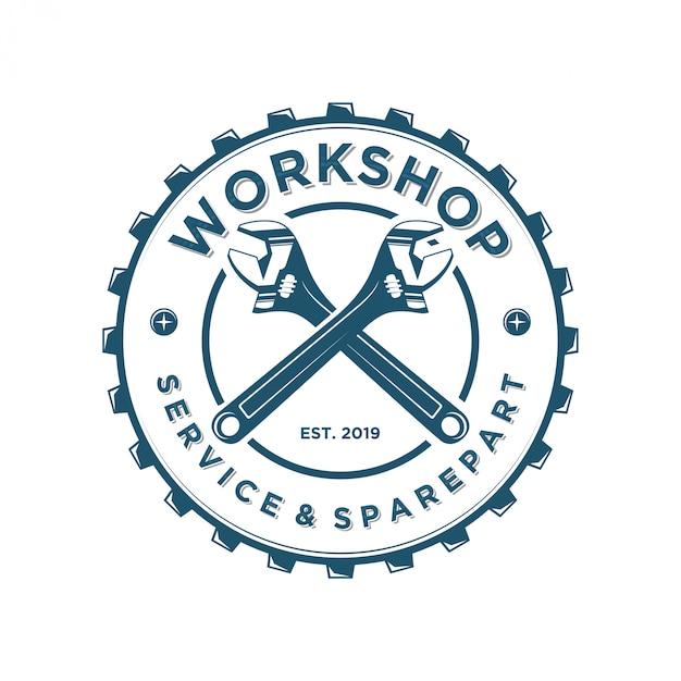 Logo sleutel voor workshops of industrie Premium Vector