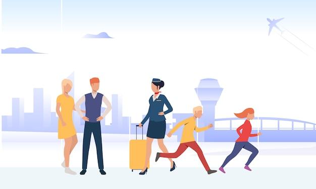 Luchthavenmedewerker die bagage vervoert Gratis Vector
