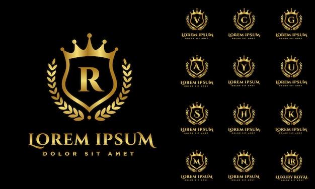 Luxe alfabetten logo set met embleem goudkleurige kleur Premium Vector