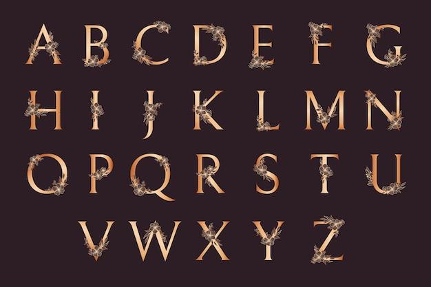 Luxe gouden alfabet met bloemen Gratis Vector