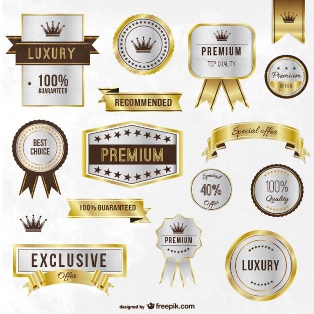 Luxe gouden etiketten en linten Gratis Vector