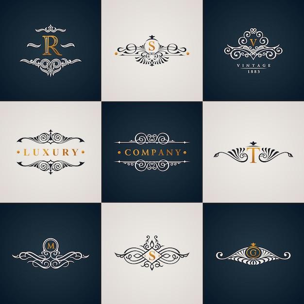 Luxe logo monogram set met vintage royal bloeit elementen Premium Vector