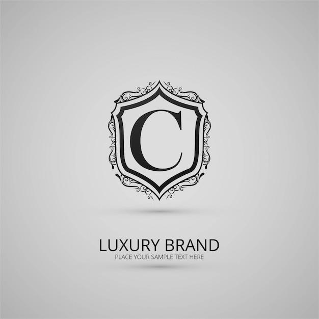 Luxe merk floral logo Gratis Vector