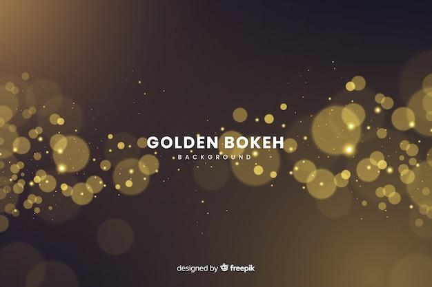 Luxeachtergrond met gouden deeltjes bokeh Gratis Vector