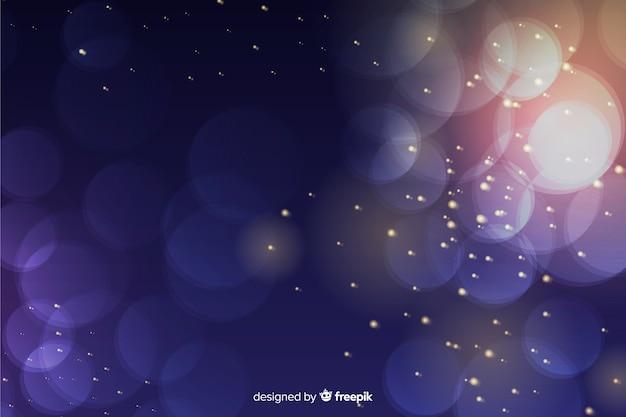 Luxeachtergrond met gouden en blauwe deeltjes bokeh Gratis Vector