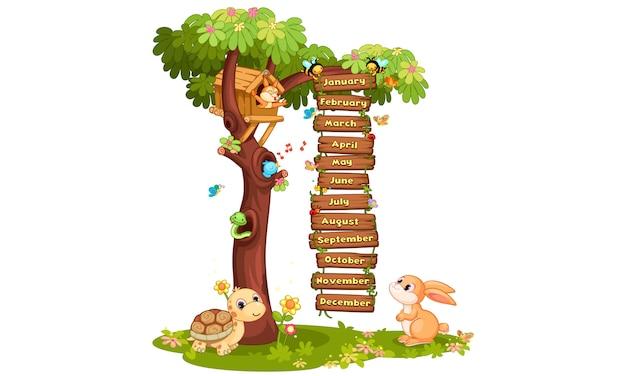 Maanden van het jaar illustratie met dieren en bomen en vogels Gratis Vector