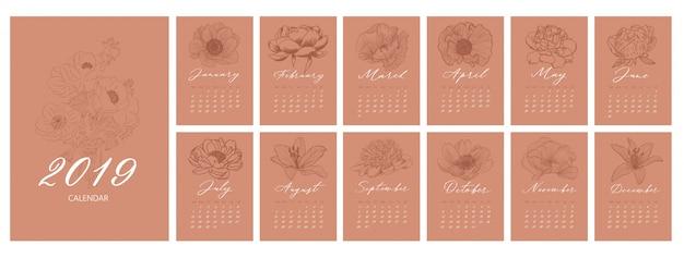 Maandkalender met bloemen Premium Vector