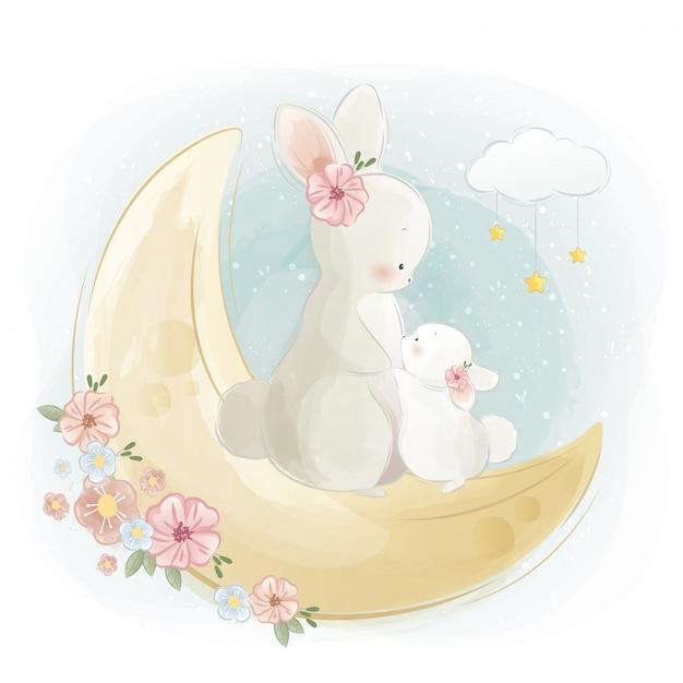 Mama en baby bunny staan op de maan Premium Vector