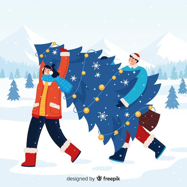 Man en vrouw die een kerstboom dragen Gratis Vector