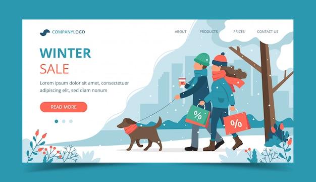 Man en vrouw met verkoopzakken, die de hond in de winterlandingspagina lopen Premium Vector