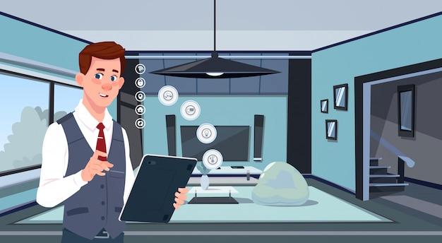 Man met digitale tablet met behulp van smart home app over woonkamer achtergrond moderne technologie van huis monitoring concept Premium Vector