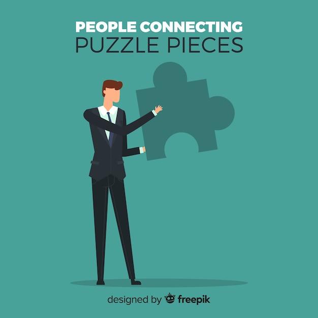 Man verbindende puzzel stukjes achtergrond Gratis Vector