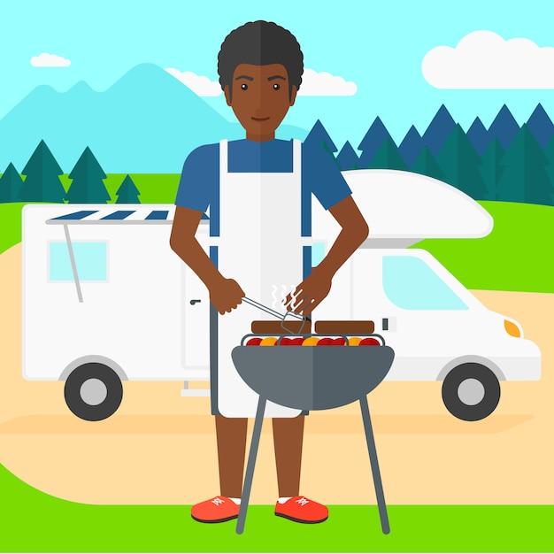 Man voorbereiding barbecue. Premium Vector