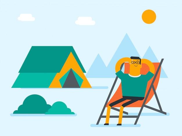 Man zit in een klapstoel op de camping. Premium Vector