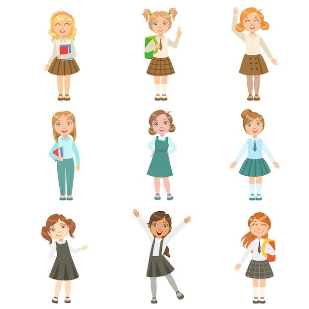 Meisjes die een assortiment van stijlvolle schooluniformen dragen Premium Vector
