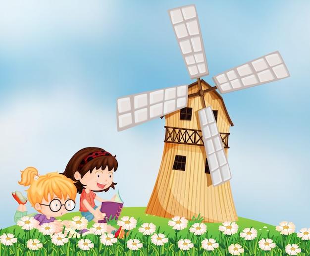 Meisjes die op de heuveltop bij het barnhouse lezen Gratis Vector