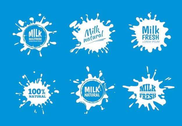 Melk badges vector set. wit spat- en vlekkenontwerp Premium Vector