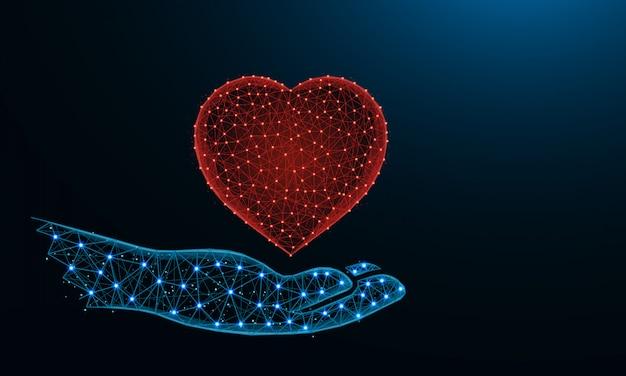 Menselijke hand en een laag poly van het hartsymbool Premium Vector