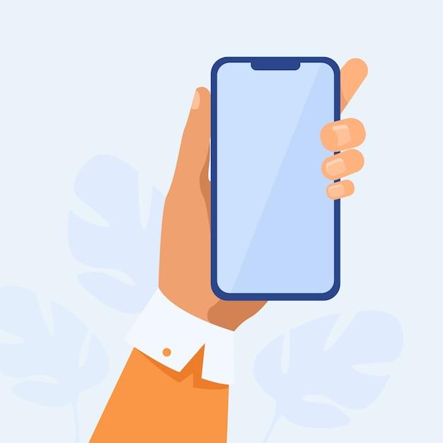 Menselijke hand met mobiele telefoon Gratis Vector