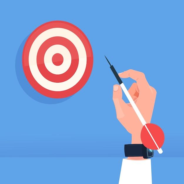Menselijke hand met pijl hit doel dartbord succesvolle doel concept plat Premium Vector