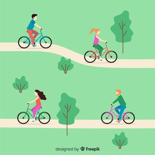 Mensen die een fiets in het park berijden Gratis Vector