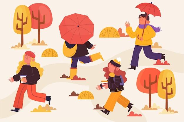 Mensen die een wandeling in een park in de herfst Gratis Vector