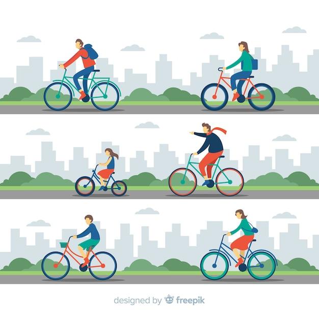 Mensen die fietsen in het park berijden Gratis Vector