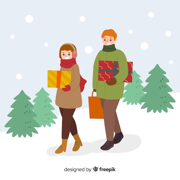 Mensen die kerstcadeaus samen kopen Gratis Vector