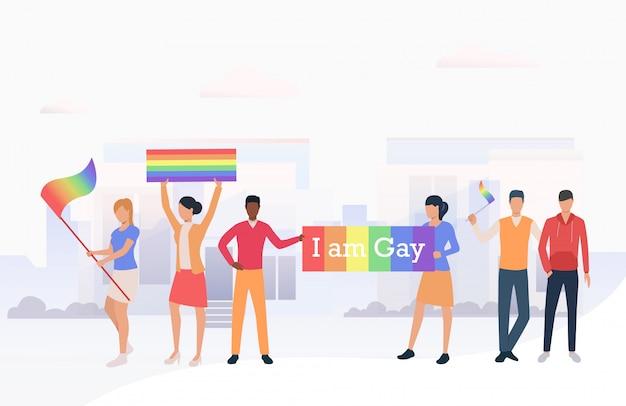 Mensen die lgbtq-vlaggen houden en ik ben een homobanner in een parade Gratis Vector