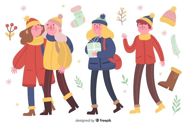 Mensen dragen set winterkleren Gratis Vector