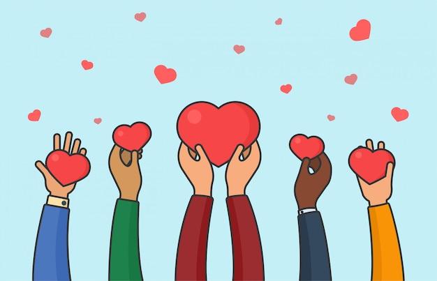 Mensen handen met harten. vrede, liefde en eenheid concept. multi-etnische liefdadigheid en donatie platte vectorillustratie Premium Vector