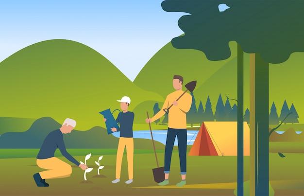 Mensen houden schoppen en planten bomen in de wilde natuur Gratis Vector
