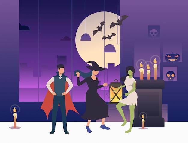 Mensen in halloween-kostuums die in donkere ruimte dansen Gratis Vector