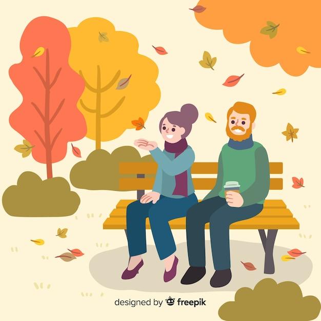 Mensen in het park in de herfst Gratis Vector