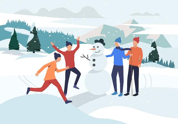 Mensen maken sneeuwpop bestemmingspagina Gratis Vector