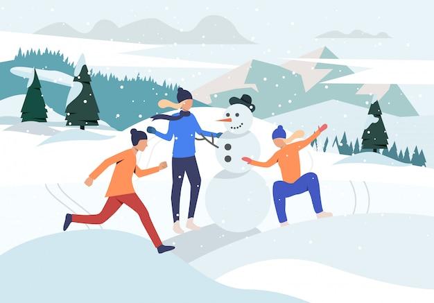 Mensen maken sneeuwpop webpagina Gratis Vector