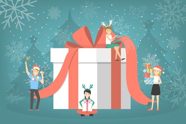 Mensen met een grote geschenkdoos. groep mensen bereiden kerstcadeau met rood lint voor. leuke verrassing. illustratie Premium Vector