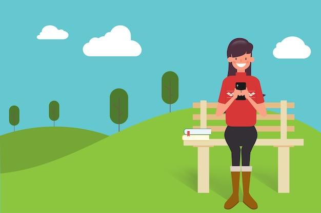 Mensen mobiel chatten in het park. Premium Vector