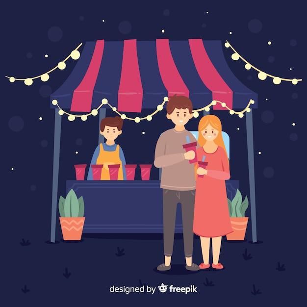 Mensen op een avondmarkt Gratis Vector